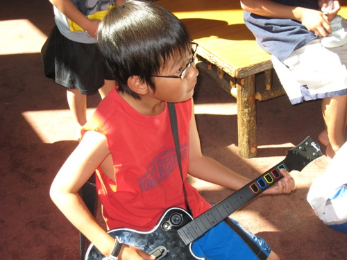 Josiah and Guitar Hero.JPG
